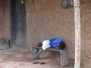 This child has probably died by now.  When I took this picture, her mother had previously been taken to an Ebola treatment unit, and the child became ill some days later.  Taken in Masokory, Sierra Leone November, 2014.
